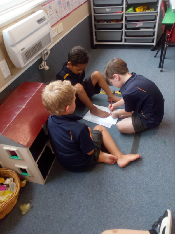 3. practising drawing around our feet