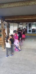 Room 11 students lining up outside their classroom showing POWER to the other classes
